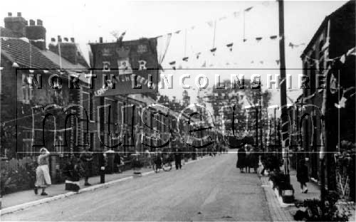 Victoria Road looking south, decorated for the Coronation of Elizabeth II, Ashby, on 2 June 1953.
