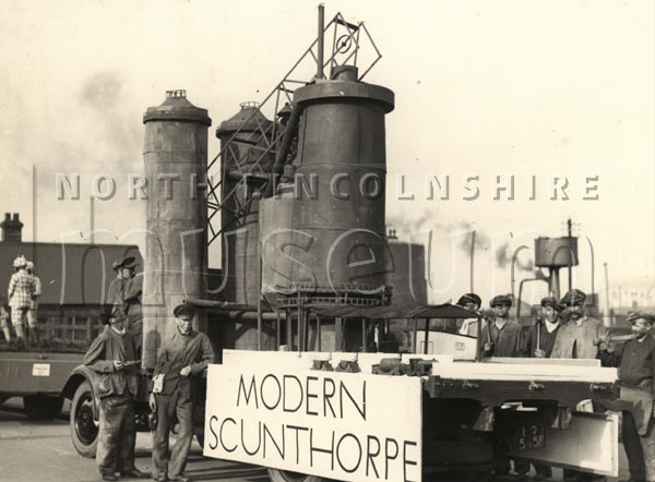 A float in the Scunthorpe Charter Day procession depicting an aspect of the town's history; 'Modern Scunthorpe', on 10 October 1936