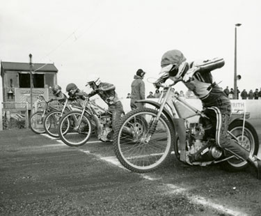Start line and racers at the Scunthorpe Speedway track, c.1980's.