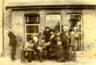 Members of the Elwes family and friends outside the dining room window of the Manor House, Bigby Street, Brigg, October 1892.